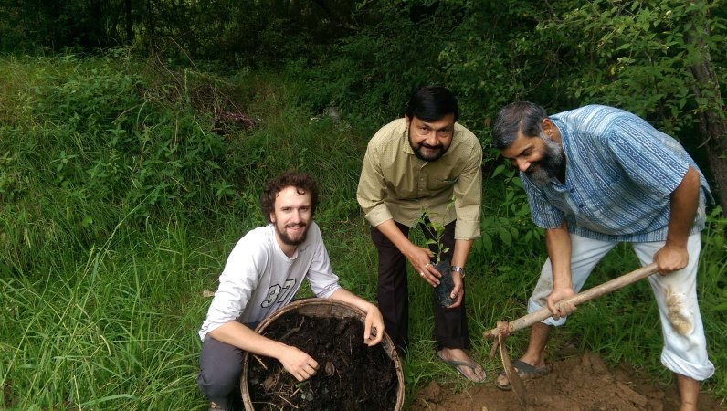 Planting trees. In this picture I am helping with the planting of lemon trees. We had a visitor from Sikkim who brought us a few lemon tree saplings. This photo was taken in August of 2016. From WSCU grad student Brandon McNamara's 2017-2018 project developing mountain resilience curriculum with Ajay Rastogi from the Foundation for the Contemplation of Nature in Majkhali, India